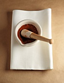 Crushed Red Pepper in Mortar with Pestle; Resting on a White Cloth