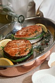 Pouring White Wine on Salmon