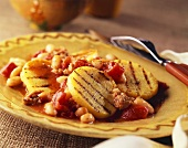 Sliced Polenta with Tomatoes, Sausage and Beans