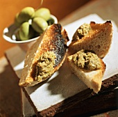 Green Olive Tapenade on Bread Pieces