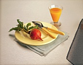 Golden Beet on Plate with Fork and Knife; Glass of Carrot Juice