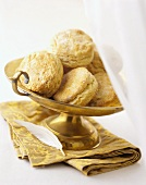 Several Biscuits in a Brass Dish