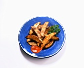 Steak Fries on a Blue Plate with Ketchup