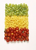 Mixed Still Life: Italian Flag made of Cherry Tomatoes, Dried Pasta and Grapes