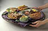 Assorted Hispanic Entrees on a Tray Being Served