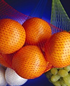 Still Life: Oranges, Grapes and Onions in Netted Bags
