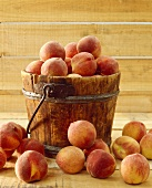 Peaches in and Around a Wooden Bucket