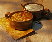Manhattan and New England Clam Chowder in Bowls