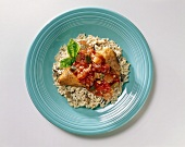 Chicken Dinner with Tomato Sauce on a Bed of Rice