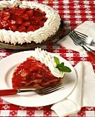 Slice of Strawberry Glaze Pie with Whole Pie