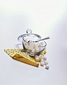 Bowl of White Sugar Cubes Resting on a Napkin