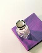Salt Shaker on a Purple Cloth