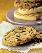 Chocolate Chip Cookie with Cookies in the Background