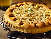 Caramelised onion and cheese tart on a cooling rack