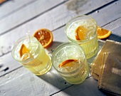 Several Glasses of Orangeade Drinks