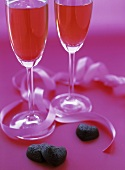 Two Glasses of Pink Champagne with Chocolate Hearts