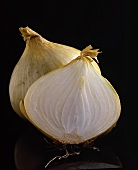 White Onion Cut in Half; Black Background
