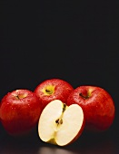 Whole Rome Beauty Apples; One Cut in Half