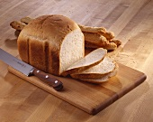 Loaf of White Bread on Cutting Board