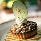 Apple tartlet with cream and apple slice