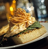 Sandwich with chicken and deep-fried onion rings