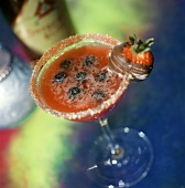 Strawberry rum cocktail with blueberries