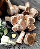 Various soup ingredients: bones, herbs, garlic
