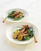 Roast beef on salad leaves with deep-fried vegetable cakes