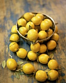 Lemons in bowl and threaded on kitchen string