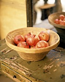Pomegranates in a terracotta bowl