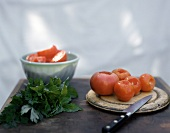Tomatoes, cut open and hollowed out; parsley