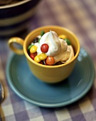 Chocolate mousse with cream & coloured chocolate beans in cup
