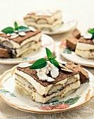 Tiramisu with flaked almonds on several plates