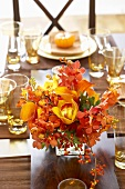 Centerpiece of Autumn Flowers on Thanksgiving Dining Table