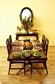 Table Set with Thanksgiving Meal in Dining Room