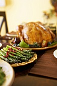 Platter of Asparagus on Table with Roasted Turkey for Thanksgiving