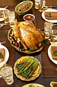 Roast Turkey and Side Dishes on Thanksgiving Table
