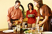 Man and Women Setting Thanksgiving Table