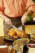 Man Carving Thanksgiving Turkey