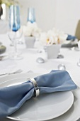 Blue Cloth Napkin on Place Setting on Table Set for Hanukkah Dinner