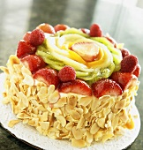 Whole Cake with Slivered Almonds Topped with Fruit