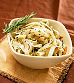Bowl of Fettucini with Roasted Vegetables and Rosemary Sprig