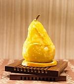 Single Orange Glazed Pear on an Orange Slice
