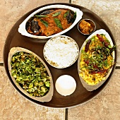 Three Assorted Indian Dishes on a Platter with White Rice