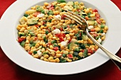 Bowl of Hot Corn Salad with a Fork