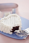 Heart Shaped Chocolate Cupcake with Vanilla Frosting with Piece Removed, Fork