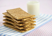 Stack of Many Graham Crackers with a Glass of Milk