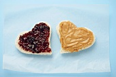 Two Heart Shaped Pieces of Bread, One with Jelly and One with Peanut Butter