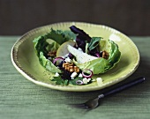 Salad with Pear Slices, Walnuts and Crumbled Goat Cheese