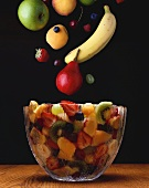 Assorted Whole Fruit Falling into a Bowl of Fruit Salad